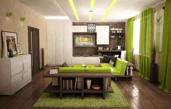 зелёный цвет делает гостиную мягкой и уютной