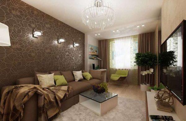 красивый и удобный диван в интерьере гостиной-спальни 18 кв.метров