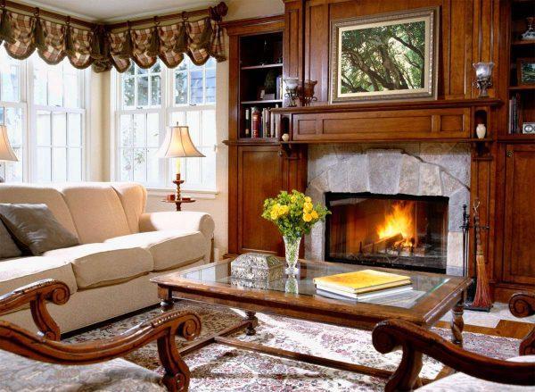 камин в интерьере гостиной в английском стиле