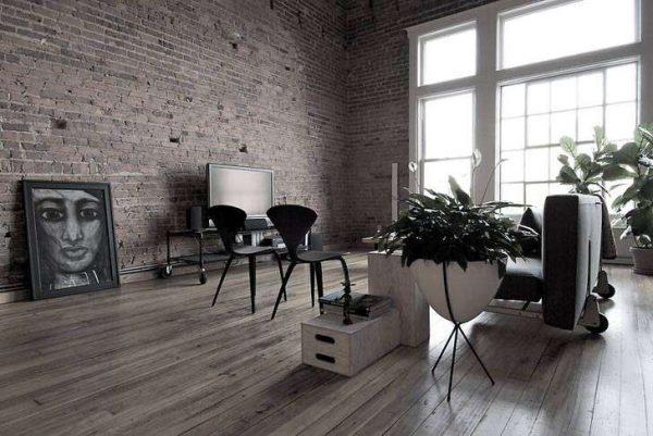 тёмно-серый ламинат в интерьере гостиной в стиле лофт