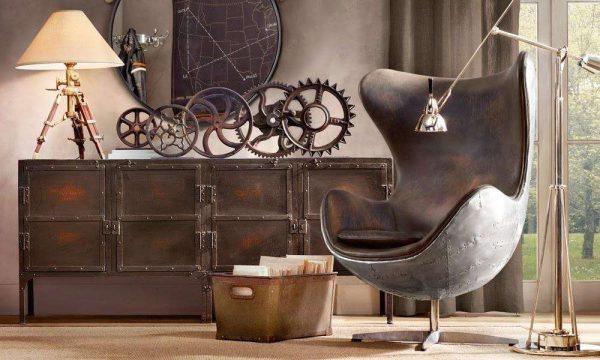 кресло в интерьере гостиной в стиле лофт