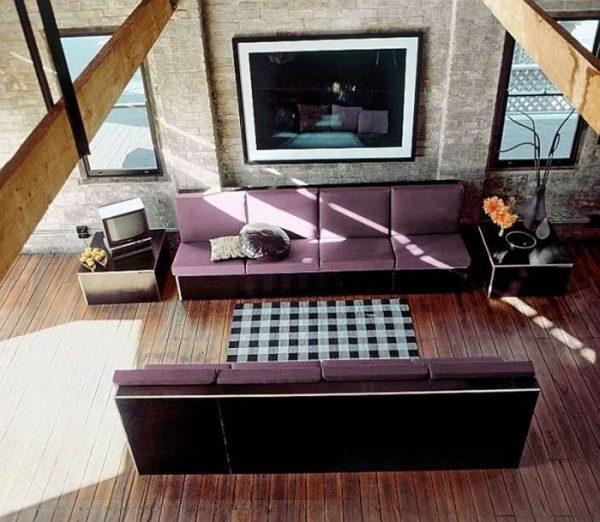 два дивана в интерьере гостиной в стиле лофт