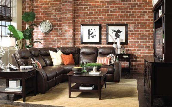 интерьер гостиной в стиле лофт угловой кожаный диван