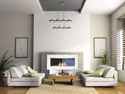 Фото дизайна гостиной с камином у стены