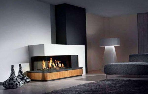 камин в интерьере гостиной в минималистическом стиле