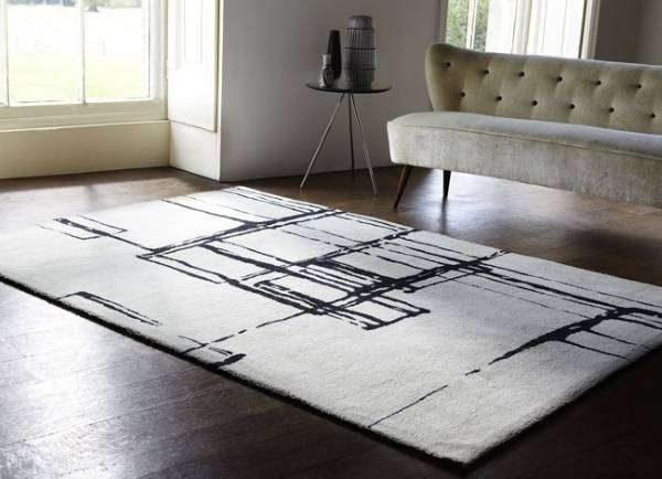 акриловый белый ковёр в интерьере гостиной