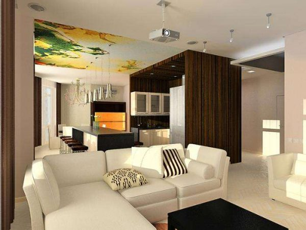 белый угловой диван добавляет свежих ноток в интерьере кухни гостиной 15 кв.м