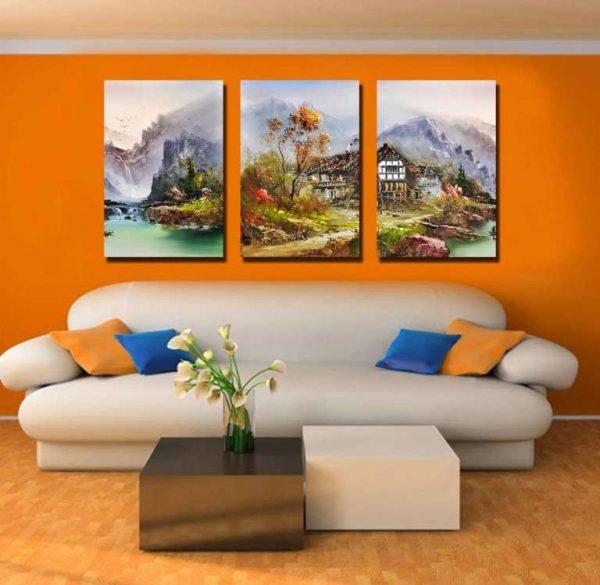 модульная картина с видом дома на фоне гор в интерьере гостиной над диваном