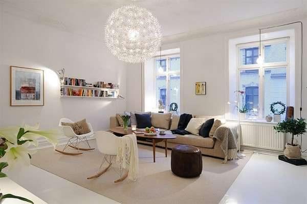 практичный диван в интерьере гостиной со скандинавским стилем