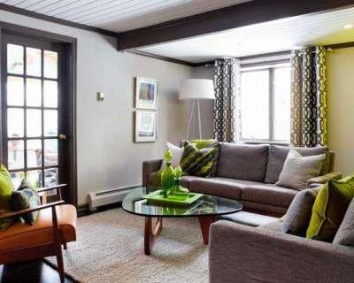 Сочетание серого и зелёного цветов в интерьере гостиной