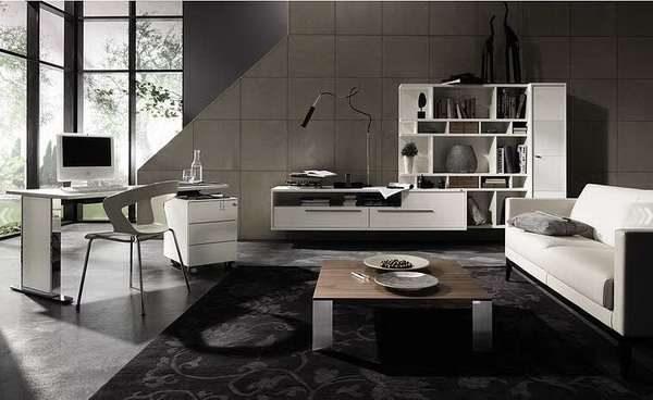 белая мебельная стенка в интерьере гостиной с серыми стенами