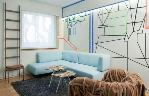 голубой угловой диван в интерьере гостиной