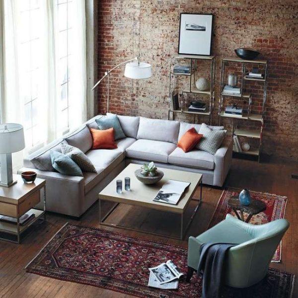 голубой угловой диван в гостиной