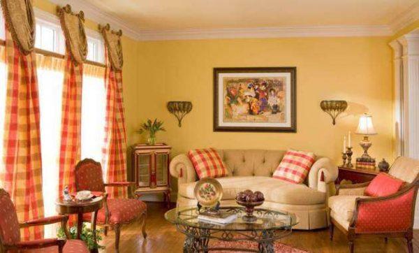 оранжевый цвет стен в интерьере гостиной очень подходит для домов