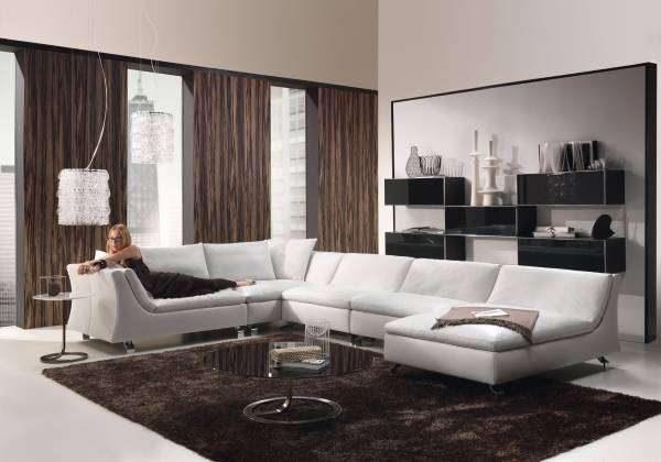 белый угловой диван в интерьере гостиной в стиле хай тек