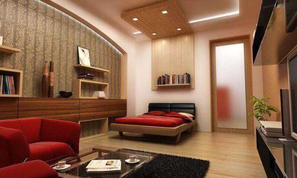 красная мебель в совмещённой спальне с гостиной