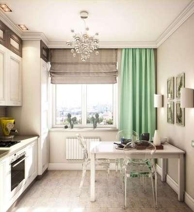 Интерьер кухни в однокомнатной квартире с декором на стенах