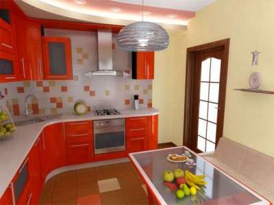 угловая мойка в интерьере красной кухни