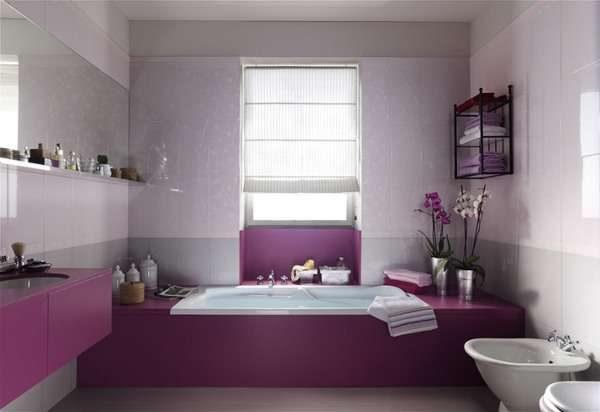 серые стены и розовая мебель в интерьере ванной комнаты