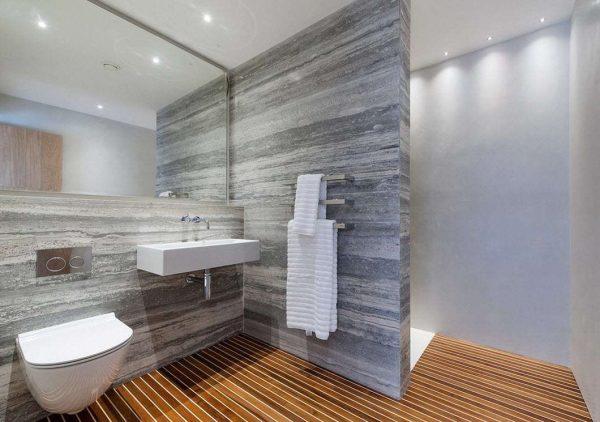 современная ванная комната с серыми стенами