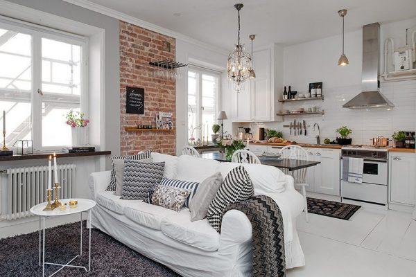 белый диван на кухне в скандинавском стиле