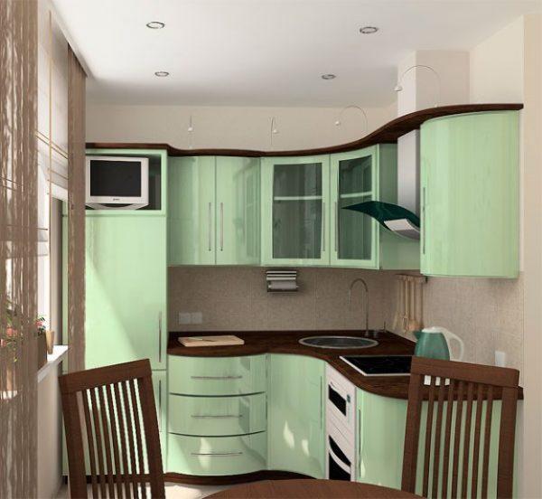 мятного цвета кухня с коричневой столешницей